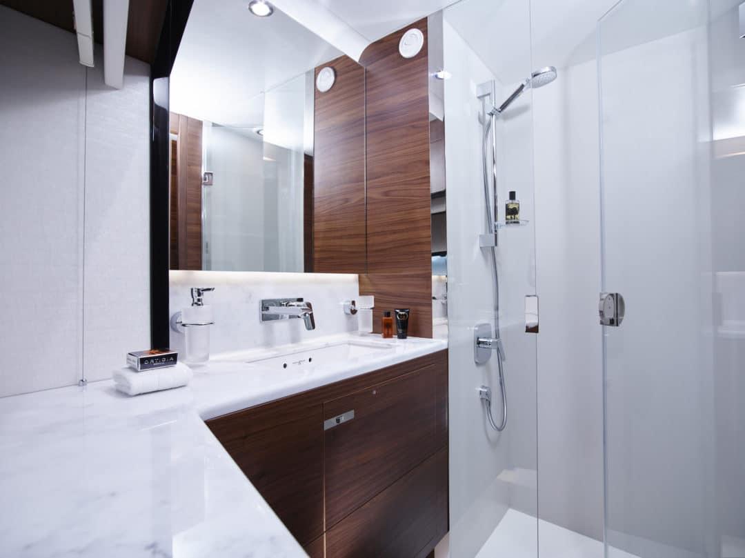 75-motor-yacht-interior-port-cabin-bathroom-american-walnut-satin