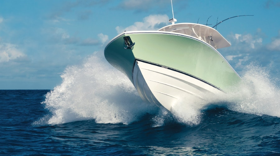 How do traditional Deep-V hull designs compare  to their high-speed, stepped hull counterparts?